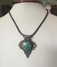 Tibetan Brass and Turquoise Pendant on Braided Leather Necklace